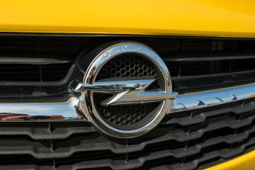 AACHEN, GERMANY MARCH, 2017: Opel logo on a yellow car. Opel AG is a German automobile manufacturer.- Stock Photo or Stock Video of rcfotostock   RC-Photo-Stock