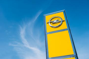 AACHEN, GERMANY MARCH, 2017: Opel official dealership logo over cloudy Sky. Opel AG is a German automobile manufacturer.- Stock Photo or Stock Video of rcfotostock | RC-Photo-Stock