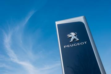 AACHEN, GERMANY MARCH, 2017: Peugeot dealership sign against blue sky. Peugeot is a French automobile manufacturer and part of Groupe PSA.- Stock Photo or Stock Video of rcfotostock | RC-Photo-Stock