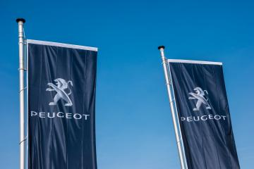 AACHEN, GERMANY MARCH, 2017: Peugeot flags against blue sky at the Peugeot Store. Peugeot is a French cars brand, part of PSA Peugeot Citroen.- Stock Photo or Stock Video of rcfotostock | RC-Photo-Stock