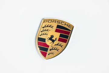 AACHEN, GERMANY MARCH, 2017: Porsche Sign Close Up on a white car. Ferdinand Porsche founded the company in 1931 with main offices in the centre of Stuttgart.- Stock Photo or Stock Video of rcfotostock | RC-Photo-Stock