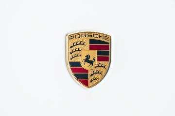 AACHEN, GERMANY MARCH, 2017: Porsche Sign Close Up on a white car. Ferdinand Porsche founded the company in 1931 with main offices in the centre of Stuttgart. : Stock Photo or Stock Video Download rcfotostock photos, images and assets rcfotostock | RC-Photo-Stock.: