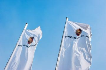 AACHEN, GERMANY MARCH, 2017: Porsche Sign on a flags against blue sky. Ferdinand Porsche founded the company in 1931 with main offices in the centre of Stuttgart. : Stock Photo or Stock Video Download rcfotostock photos, images and assets rcfotostock | RC-Photo-Stock.: