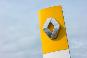 AACHEN, GERMANY MARCH, 2017: Renault dealership sign against cloudy sky. Renault S.A. is a French car manufacturer producing cars, vans, buses, trucks, tractors, tanks, autorail vehicles- Stock Photo or Stock Video of rcfotostock | RC-Photo-Stock