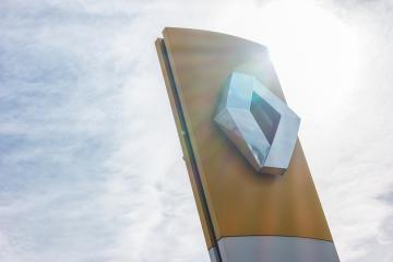AACHEN, GERMANY MARCH, 2017: Renault dealership sign against cloudy sky with sunlight. Renault S.A. is a French car manufacturer producing cars, vans, buses, trucks, tractors, tanks, autorail vehicles : Stock Photo or Stock Video Download rcfotostock photos, images and assets rcfotostock | RC-Photo-Stock.: