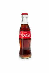 AACHEN, GERMANY OCTOBER, 2017: 250ml Classic Coca-Cola glass bottle isolated on white background. Coca-Cola Company is the most popular market leader in Germany.- Stock Photo or Stock Video of rcfotostock | RC-Photo-Stock