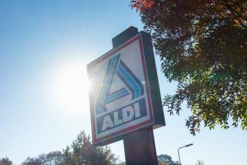 AACHEN, GERMANY OCTOBER, 2017: Aldi sign (north division) against blue sky with sunlight. Aldi is a leading global discount supermarket chain with almost 10,000 stores in 18 countries. : Stock Photo or Stock Video Download rcfotostock photos, images and assets rcfotostock | RC-Photo-Stock.: