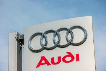 AACHEN, GERMANY OCTOBER, 2017: Audi dealership logo against blue sky. Audi is a German automobile manufacturer that designs, engineers, produces, markets and distributes luxury automobiles.- Stock Photo or Stock Video of rcfotostock | RC-Photo-Stock