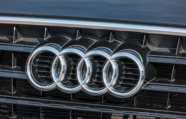 AACHEN, GERMANY OCTOBER, 2017: Audi emblem on a car grill. Audi is a German automobile manufacturer that designs, engineers, produces, markets and distributes luxury automobiles- Stock Photo or Stock Video of rcfotostock | RC-Photo-Stock
