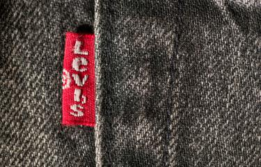AACHEN, GERMANY OCTOBER, 2017: Close up of the LEVI'S label on gray jeans. LEVI'S is a brand name of Levi Strauss and Co, founded in 1853- Stock Photo or Stock Video of rcfotostock | RC-Photo-Stock