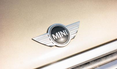 AACHEN, GERMANY OCTOBER, 2017: Mini cooper logo on a golden car. It is a model produced by BMW since 2000. BMW is a German luxury vehicle, motorcycle, and engine manufacturing company founded in 1916.- Stock Photo or Stock Video of rcfotostock | RC-Photo-Stock