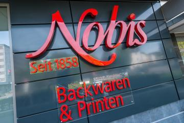 AACHEN, GERMANY OCTOBER, 2017: Nobis Store Logo. Nobis Printen is a family-run bakery company since 1858, with 38 bakeries and bakery cafes in and around Aachen germany.- Stock Photo or Stock Video of rcfotostock | RC-Photo-Stock