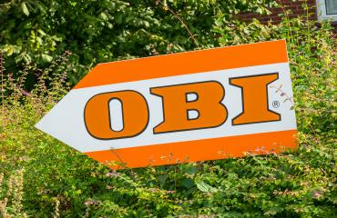 AACHEN, GERMANY OCTOBER, 2017: OBI market sign on a shield. Obi is the largest hardware and do-it-yourself retailer in Germany.- Stock Photo or Stock Video of rcfotostock | RC-Photo-Stock