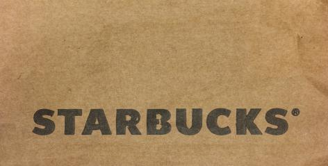 AACHEN, GERMANY OCTOBER, 2017: Starbucks Logo on a paper bag. Starbucks is the largest coffeehouse company in the world, with 20,891 stores in 62 countries.- Stock Photo or Stock Video of rcfotostock | RC-Photo-Stock