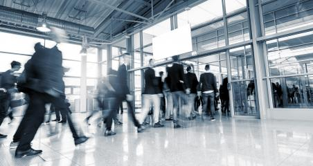 Abstract Image of Business People Walking at a International Trade Fair- Stock Photo or Stock Video of rcfotostock | RC-Photo-Stock