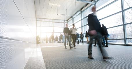 Abstract Image of businesspeople walking on tradeshow entrance- Stock Photo or Stock Video of rcfotostock | RC-Photo-Stock