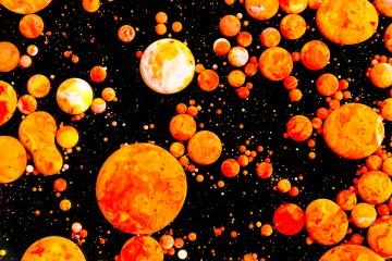 Abstract orange paint balls on black- Stock Photo or Stock Video of rcfotostock | RC-Photo-Stock