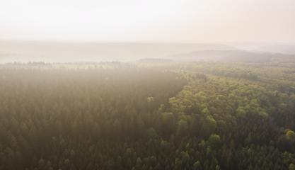 Aerial drone view of a scenic Landscape with mountains covered in clouds and fog.- Stock Photo or Stock Video of rcfotostock | RC-Photo-Stock