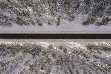 Aerial drone view of road in idyllic winter landscape at sunset. Street running through the nature from a birds eye view- Stock Photo or Stock Video of rcfotostock | RC-Photo-Stock