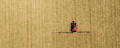 Aerial image of tractor spraying soil and young crop in springtime in field- Stock Photo or Stock Video of rcfotostock | RC-Photo-Stock