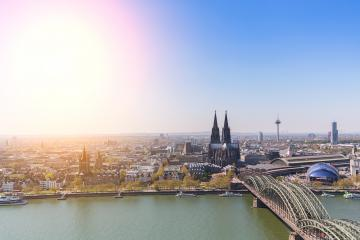 Aerial of the Hohenzollern bridge over Rhine river on a sunny day. Beautiful cityscape of Cologne, Germany  with cathedral and Great St. Martin Church in the background- Stock Photo or Stock Video of rcfotostock | RC-Photo-Stock