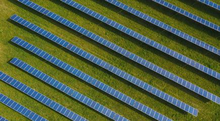 Aerial top down photo of solar panels PV modules mounted on ground photovoltaic solar panels absorb sunlight as a source of energy to generate electricity creating sustainable energy- Stock Photo or Stock Video of rcfotostock | RC-Photo-Stock