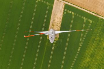 Aerial top down picture of wind turbine a device that converts the wind's kinetic energy into electrical energy providing renewable energy sustainable energy into the electricity grid- Stock Photo or Stock Video of rcfotostock | RC-Photo-Stock