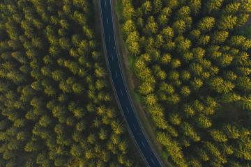 Aerial top view over mountain road going through forest.- Stock Photo or Stock Video of rcfotostock | RC-Photo-Stock