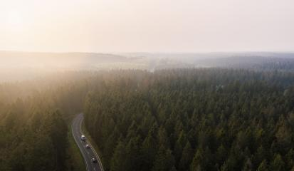Aerial view of a mountain road covered in fog within a green forrest as spotted from above with a drone (Germany, Europe) : Stock Photo or Stock Video Download rcfotostock photos, images and assets rcfotostock | RC-Photo-Stock.: