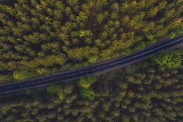 Aerial view of a road in the middle of the forest- Stock Photo or Stock Video of rcfotostock | RC-Photo-Stock