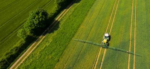 Aerial view of a tractor spraying the field. Chemistry in agriculture from drone view. Modern farming background concept.- Stock Photo or Stock Video of rcfotostock | RC-Photo-Stock