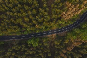 Aerial view of car driving through the forest on country road.  : Stock Photo or Stock Video Download rcfotostock photos, images and assets rcfotostock | RC-Photo-Stock.: