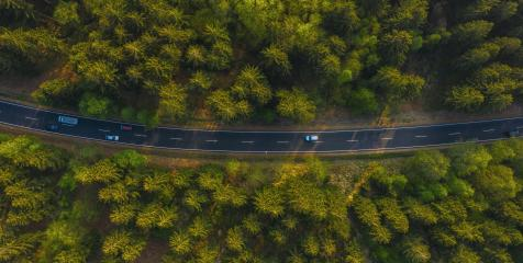 Aerial view of cars driving through the forest on country road. - Stock Photo or Stock Video of rcfotostock | RC-Photo-Stock
