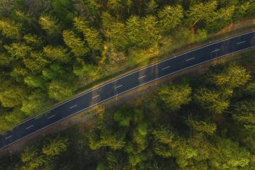 Aerial view of countryside road passing through the green forrest and mountain- Stock Photo or Stock Video of rcfotostock | RC-Photo-Stock