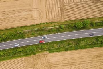 Aerial view of traffic on two lane road through countryside and cultivated fields- Stock Photo or Stock Video of rcfotostock | RC-Photo-Stock