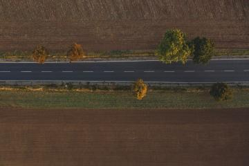 Aerial view of traffic on two lane road through countryside and cultivated fields at autumn- Stock Photo or Stock Video of rcfotostock | RC-Photo-Stock