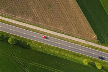 Aerial view of two lane road through countryside and cultivated fields with cars. Drone shot- Stock Photo or Stock Video of rcfotostock | RC-Photo-Stock