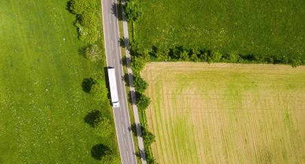 Aerial view of two lane road through countryside and cultivated fields with white truck. Drone shot and copy space for text- Stock Photo or Stock Video of rcfotostock | RC-Photo-Stock