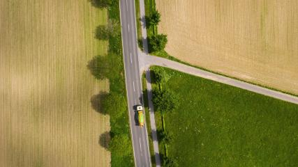 Aerial view of two lane road through countryside and cultivated fields with cars. Drone shot and copy space for text- Stock Photo or Stock Video of rcfotostock | RC-Photo-Stock