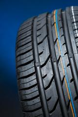 all season car tire on blue background : Stock Photo or Stock Video Download rcfotostock photos, images and assets rcfotostock | RC-Photo-Stock.: