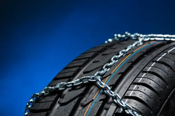 all season tire with snow chains on blue background : Stock Photo or Stock Video Download rcfotostock photos, images and assets rcfotostock | RC-Photo-Stock.: