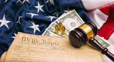 American Constitution with judge gavel and gun cartridges and dollar notes : Stock Photo or Stock Video Download rcfotostock photos, images and assets rcfotostock | RC-Photo-Stock.: