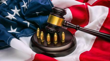 American flag with judge's gavel and gun cartridges - symbolizing the American justice system for gun crime : Stock Photo or Stock Video Download rcfotostock photos, images and assets rcfotostock | RC-Photo-Stock.: