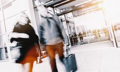anonymous blurred business people at a trade show entrance- Stock Photo or Stock Video of rcfotostock | RC-Photo-Stock