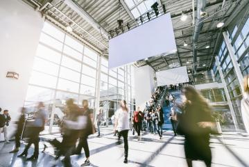 Anonymous blurred business people rushing in a hall of a trade fair- Stock Photo or Stock Video of rcfotostock   RC-Photo-Stock