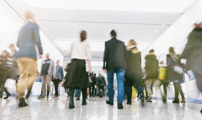 Anonymous blurred business people rushing in a hall of a trade fair- Stock Photo or Stock Video of rcfotostock | RC-Photo-Stock