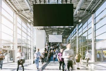 Anonymous Blurred businesspeople at a trade fair- Stock Photo or Stock Video of rcfotostock | RC-Photo-Stock