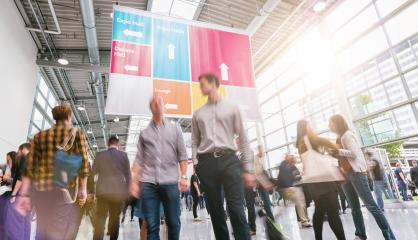 Anonymous Blurred businesspeople rushing at a trade fair- Stock Photo or Stock Video of rcfotostock | RC-Photo-Stock