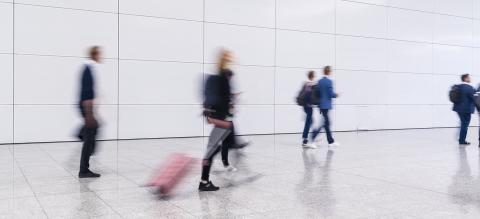 Anonymous blurred crowd of business people walks by gear on a trade fair or in an airport- Stock Photo or Stock Video of rcfotostock | RC-Photo-Stock