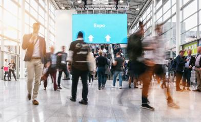 anonymous blurred people rushing at a expo- Stock Photo or Stock Video of rcfotostock | RC-Photo-Stock
